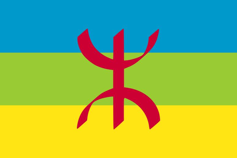 La lettre YAZ, 30eme lettre de l'alphabet berbère, s'y inscrit sur trois bandes horizontales de même largeur (bleu, vert et jaune). (c) Mysid, Wikipedia.