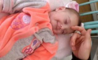 Eden après son opération qui sourit à la vie. Photo d'archives personnelles (c) Kelly