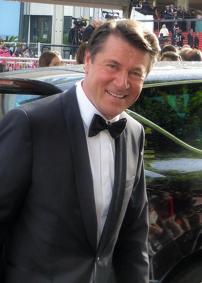 C. Estrosi, maire de Nice, s'apprêtant à monter les marches du festival de Cannes. Des projets plein la tête pour les studios de la Victorine. Photo (c) T. Gabbo (Flickr)