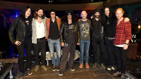 Todd Kerns, Frank Sidoris, Myles Kennedy and Slash with Ben Johnston, Simon Neil, Richard Ingram and James Johnston of Biffy Clyro pose on stage at the World Stage Open Rehearsal ahead of the MTV EMA's 2014 at the 02 Academy on November 7, 2014 in Glasgow, Scotland. Photo (c) Ian Gavan/MTV 2014/Getty Images